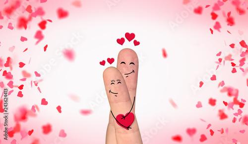 Leinwandbild Motiv Happy finger couple in love celebrating Valentine's day