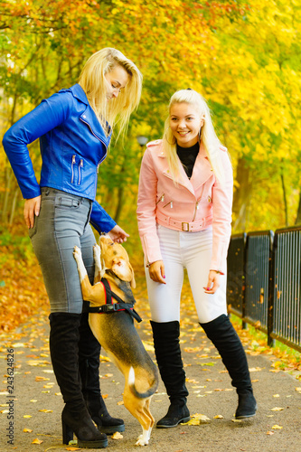 Females wearing fashionable autumn outfits