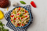 Italian fusilli pasta in a salad with ham and vegetables.
