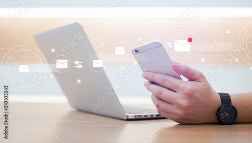 close up businessman holding smartphone and checking email online on web with virtual interface technology concept