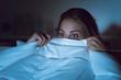 Leinwandbild Motiv Woman watching an horror movie