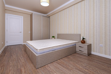 New empty brown bedroom with twin bed and bedside tables © starush
