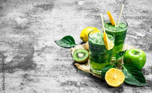 Green smoothie with Apple, kiwi and herbs. © Artem Shadrin