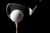 Closeup of Golf Club and Golf Ball on Tee, Isolated on White