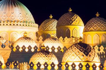 Domes of mosque in Hurhgada. Architecture and religion concept