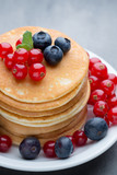 Stack of pancakes with blueberry and fresh berry. - 243651054