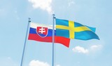Sweden and Slovakia, two flags waving against blue sky. 3d image