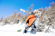 Quadro Loving couple together in winter vacation Woman pointing at sky