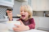 Boy having his breakfast at home - 243667004