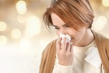 Cold woman holding handkerchieif blowing nose - 243668430