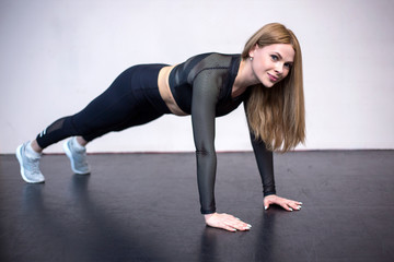 sporty beautiful woman exercising in a gym © Анна Волгина
