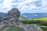 Summer landscape with a stone on top of the Carpathian Mountains.