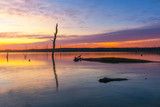 Beautiful sunrise over a lake with colorful reflections  - 243683488