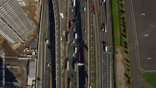 Wall mural Tokyo, Japan circa-2018.  Flying directly over freeway in Tokyo.  Shot from helicopter with RED camera.