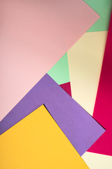 Colorful polygon paper design. Pastel tones geometric shapes background.