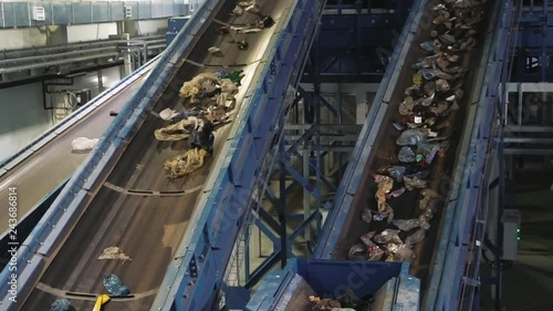 Waste processing plant. Waste on shipping tape. Waste sorting