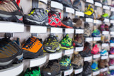Photo of sport shoes selling in sports store - 243695416