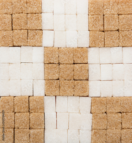White and brown sugar cubes creative background