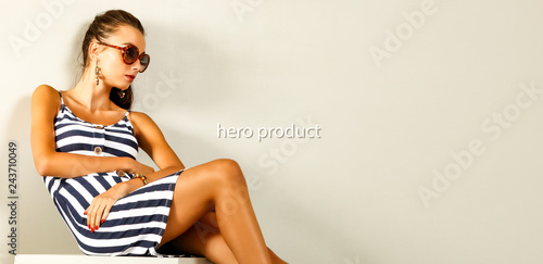 Leinwanddruck Bild Spring time and slim young woman in studio