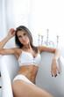 Leinwanddruck Bild - Woman in white lingerie