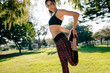 Fit young woman stretching legs at he park