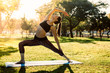 Woman practising yoga pose at the park