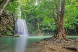 Erawan Waterfall, beautiful silky water flowing on arch rock around with green forest background, floor 3th Erawan waterfall, Kanchanaburi, Thailand.