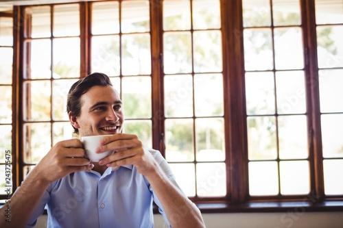 Man having coffee in restaurant