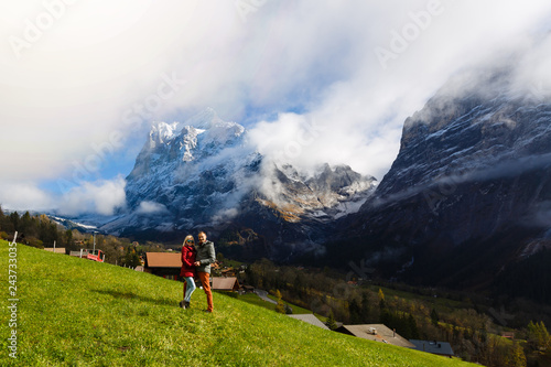 Young couple of travelers enjoying a mountains view, Grindelwald Switzerland