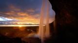 Seljalandsfoss waterfall at sunset, Iceland - 243734230