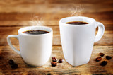Cup of hot black coffee with coffee beans