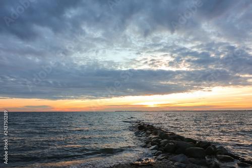 Acrylglas Pier breakwater seascape, burial at sea