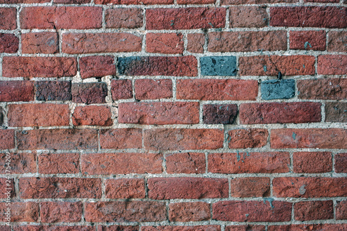 Fragment of the old brickwork close-up. Potholes and defects of red bricks. - 243754209