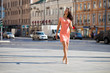Young beautiful brunette woman walking on the street