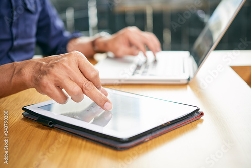 Poster Businessman using application on tablet computer when working in office