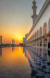 Fototapeta Fototapety pomosty - Sunset at the Grand Mosque in Abu Dhabi © mb14