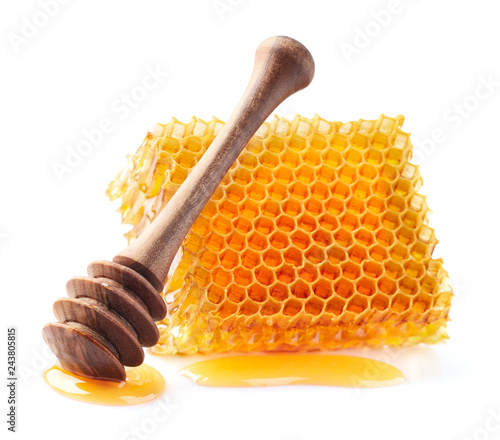 Honeycomb with spoon in closeup © Dionisvera