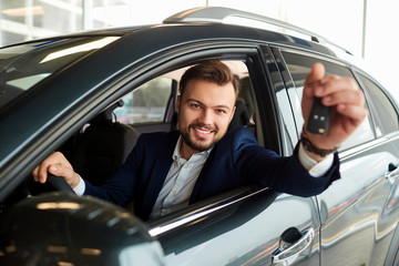 Male driver smiling holds the keys to the car © Studio Romantic