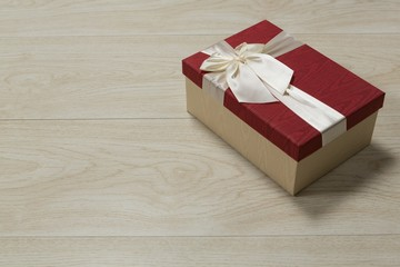 Gift box on a wooden table © wavebreak3