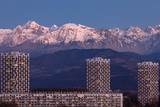 Grenoble, France, January 2019 : the three towers in front the belledonne mountains at sunset, ile verte neighbourhood - 243817602