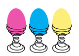 three colorful eggs on a white background