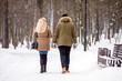 A guy and a girl walking in winter Park
