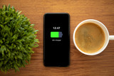 touch phone with charged battery on the screen - 243847677