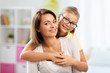 people and family concept - portrait of happy mother and daughter at home