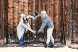 Fototapeta Panele - Verliebtes Paar im Winter Valentinstag machen ein Herz mit den Armen  © drubig-photo