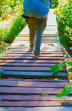 The image of walking across the wooden bridge of tourists and na