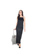 happy elegant female traveler in black dress walking with suitcase isolated on white