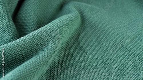 Green fabric macro seam pattern blurred background