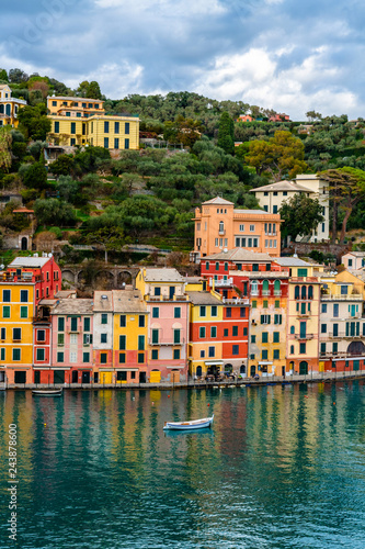 Traditional colorful mediterranean houses with boat on the sea in spectacular harbor of Portofino, Liguria, Italy