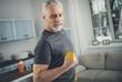 Grey-haired elderly man loving sport exercises